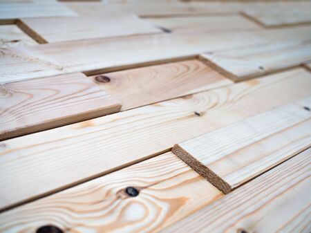 Decorative panels assembled from the boards of natural wood