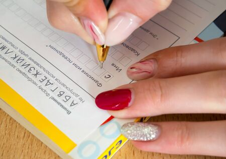 Filling in details in the examination form Imagens