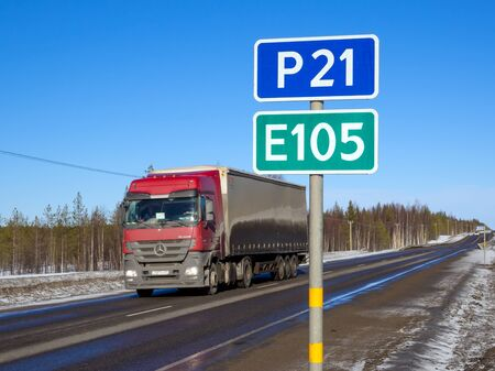 Murmansk, Russia - March 30, 2019: Truck rides on the highway