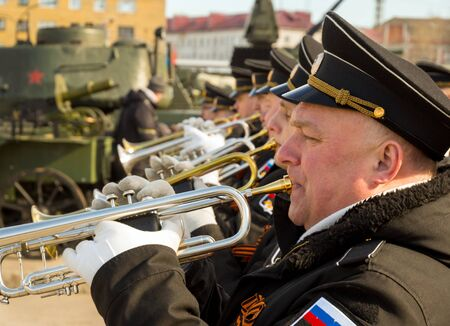 Murmansk, Russia - April 22, 2019: Orchestra of military sailors performs the march