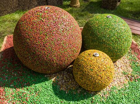 Landscape composition of colorful balls made of stone chips