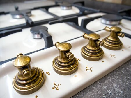 Stylish bronze handles of the new gas stove