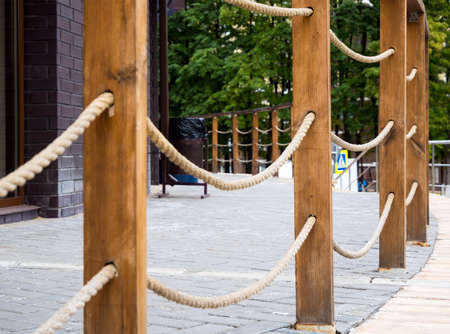 Railing in the form of wooden posts with tensioned ropes