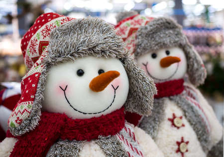 Voronezh, Russia - December 22, 2019: Toys snowmen in winter hats with earflaps and scarves