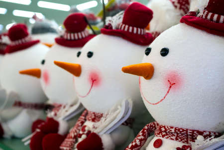 Toys in the form of snowmen standing in a row