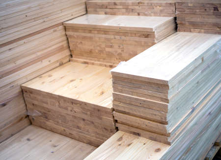 Stacks of wooden boards of various sizes