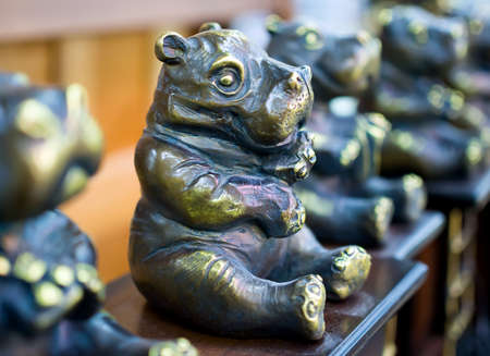 Souvenir in the form of a small bronze hippo Stock Photo