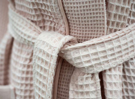 Tied waistband of a bathrobe with a waffle fabric texture