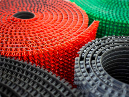 Rolled up plastic anti-slip carpets