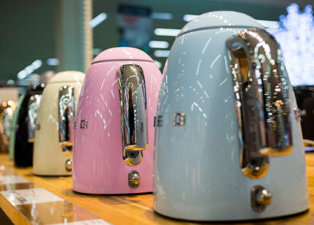 Voronezh, Russia - December 22, 2019: Standing in a row, new plastic electric kettles Editorial