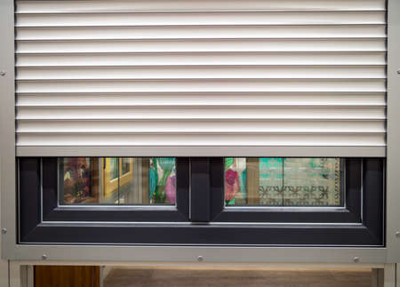 Roller shutters installed on a plastic window Stock Photo