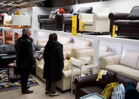 Russia, Moscow - January 01, 03: Buyers choose upholstered furniture in the