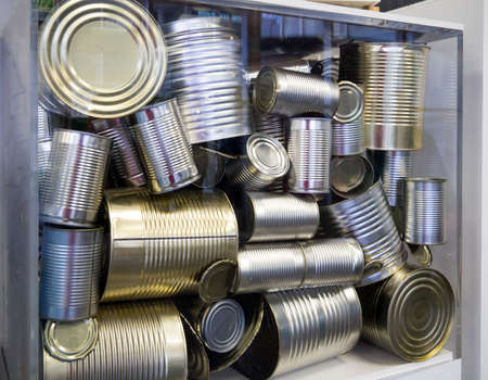 Acceptance of old metal cans for disposal Stock Photo