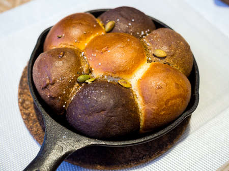 Bread of various types in the form of buns served in a pan Stock Photo
