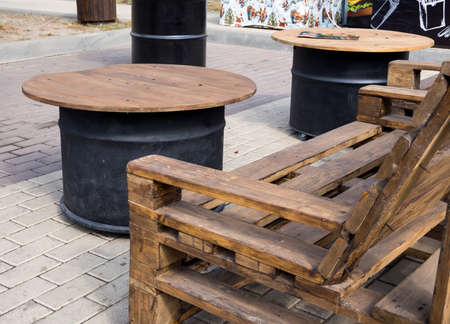 Bench from old pallets and tables from metal drums