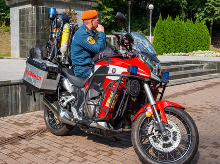 Russia, Voronezh - September 2019, 08: An Emergencies Ministry employee sits on a specialized motorcycle of the fire service Editorial