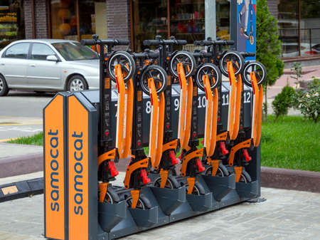 Russia, Voronezh - August 2019, 24: Parking of electric scooters in the residential complex