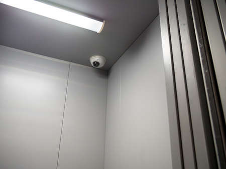 CCTV camera is installed on the ceiling of the elevator car