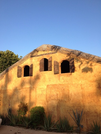 art: An orange wall with three open windows antique style. Stock Photo