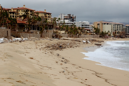 decimated: Damaged by hurricane Odile Medano beach front houses with trash on the beach Editorial