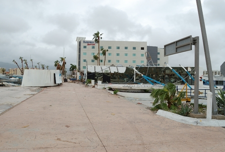 decimated: Broken building. Hurricane Odile blow away its roof to the road Editorial