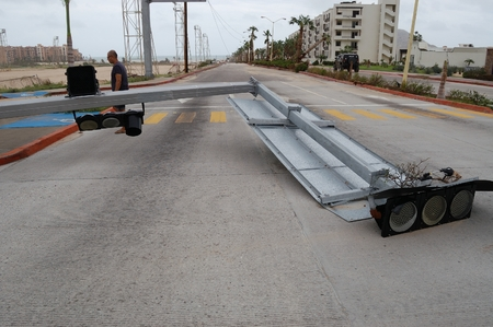 decimated: Broken by hurricane Odile traffic light on tthe middle of the road