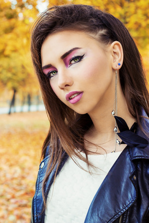 portrait of a beautiful girl in rock style with bright makeup photo