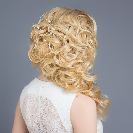 beautiful young girl in the image of the bride, beautiful wedding hairstyle with flowers in her hair, hairstyle for bride