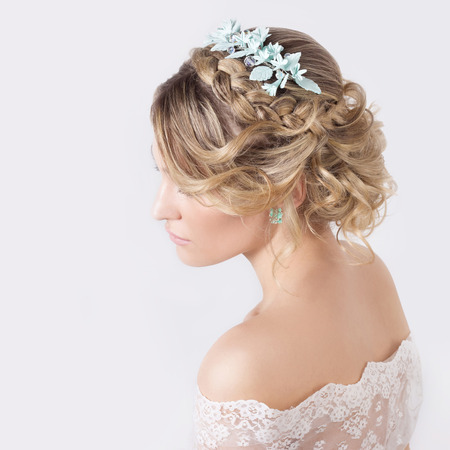 beautiful young sexy elegant sweet girl in the image of a bride with hair and flowers in her hair , delicate wedding makeup