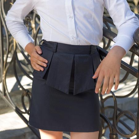 uniform skirt: school uniform for girls, black skirt Stock Photo