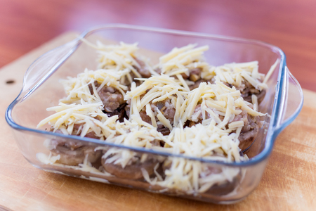 Stuffed mushrooms champignons with cheese cooked in the oven Stock Photo