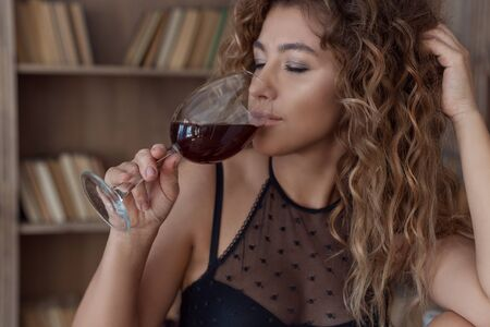 beautiful lovely girl with spots Vitiligo in her arms with a glass of wine