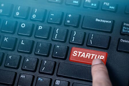 Startup button on black computer keyboard,startup background concept