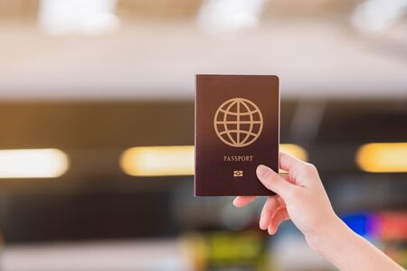 A traveler holding passport in airport