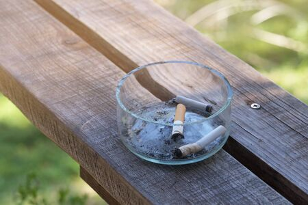 Cigarette butts in the ashtray