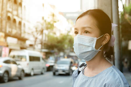Asian travelers girl with medical face mask to protection the coronavirus in public areas