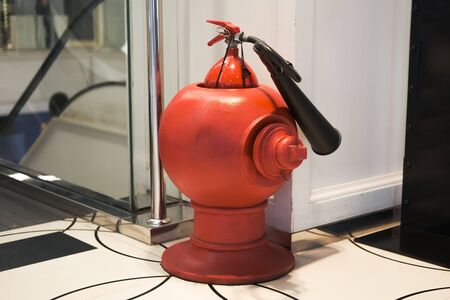 Red Fire extinguisher in building
