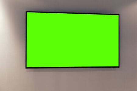 Green screen on digital LCD television on white wall