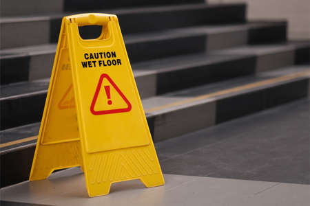 yellow sign of caution reserve cleaning on the wet floor