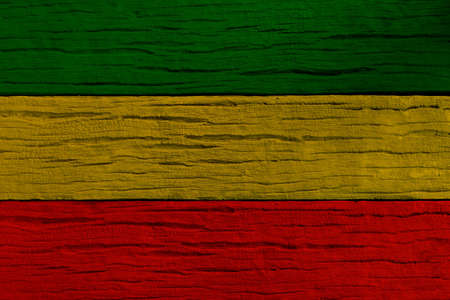 Green yellow red on wood texture background, reggae background. Banque d'images
