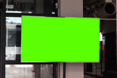 Green screen LCD TV attached to the wall. 版權商用圖片