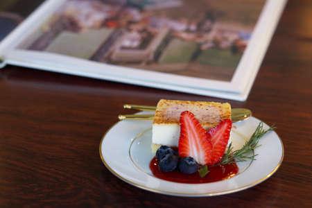 strawberry cheesecake on white dish in cafe Stok Fotoğraf