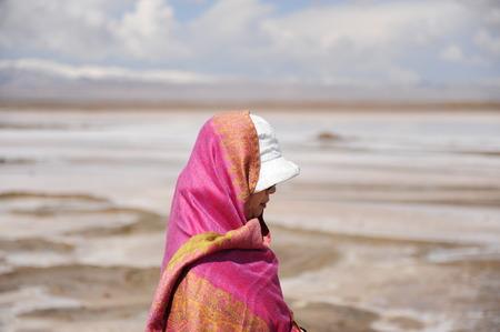 cloud capped: Chinese woman standing at  Chakayan lake
