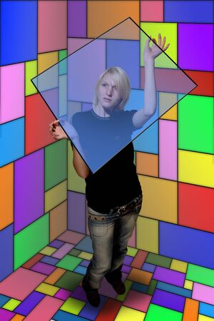 The girl is construct puzzle from the color wall panel Stock Photo - 2065225
