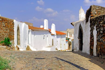 hollidays: Portugal, area of Alentejo, Evoramonte: typical architecture; white houses in a sunny day, the typical image of south region