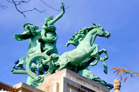 France, Paris: famous monuments statue of Grand Palais; bronze color horses on the top of the grand palais roof; blue sky and horses movement Stock Photo - 2516207