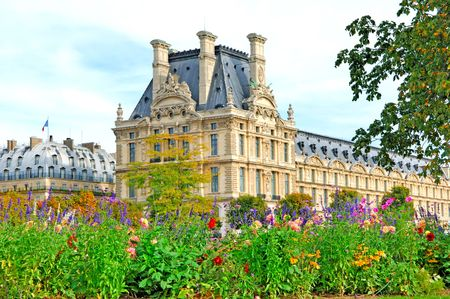 France, paris: Louvre museum; view from the gardens. summer season with green trees and blue flowers. Stock Photo - 2520579