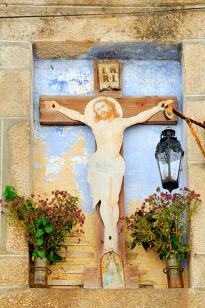 lima province: Portugal, Ponte de Lima: ancient statue of a Christ on a cross on  a wall