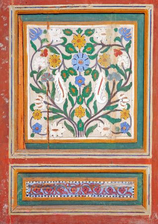 Morocco, Marrakech, Marrakesh: Architectural detail of the Bahia Palace; traditional painting wood with a typical floral design in blue, white and green