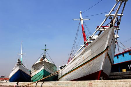 shipper: Indonesia, Jakarta: boats at Sunda Kelapa an ancient sea port; one of the most famous for the construction of the traditional wood boats; blue sky and colorful big wood boats Stock Photo